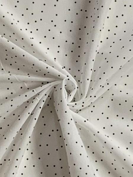 Schwarze Punkte auf weißem Hintergrund